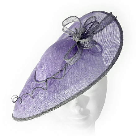Saucer style lilac and grey fascinator with coiled trim and bow detail. Ideal for Mother of the Bride and wedding guests.