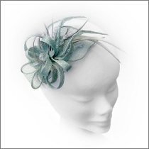 Small paleaqua green headpiece ideal for wedding guest, Mother of the Bride or bridesmaid; with feathers and crystals.