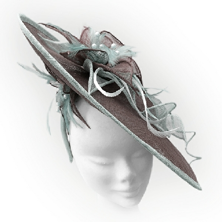 Upturned brim brown and mint green hatinator with feathers and flower detail. Perfect for Mother of the Bride and wedding guests.