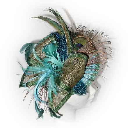 Exotic turquoise, green and gold disc fascinator with luxury feathers for weddings and ladies day at the races.