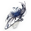 Large stylish navy and white fascinator ideal for Mother of the Bride or ladies day at the races; with long exotic feathers.
