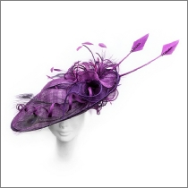 Stunning magenta pink peacock feather wedding fascinator; perfect for wedding guests, Mother of the Bride or the races.