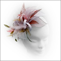Dainty pink, bronze and red orange feather headpiece ideal for wedding guest, Mother of the Bride or bridesmaid.