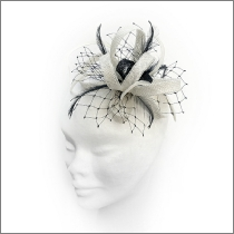 Dainty black and ivory white loop fascinator with feathers; perfect for wedding guests, Mother of the Bride or bridesmaids.