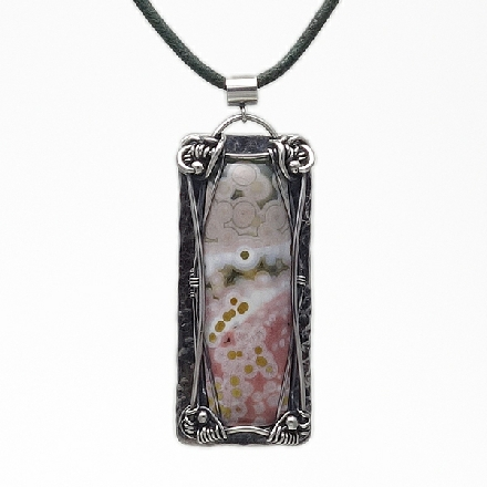 Beautiful hand-cut Mokaite Jasper round pendant